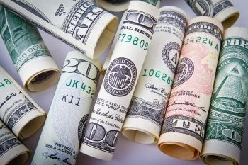 Rolled-Up Ten, Twenty, and One-Hundred Dollar Bills | What Is the Cost of Divorce in NJ?
